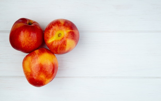 Top view of fresh ripe nectarines isolated on white with copy space
