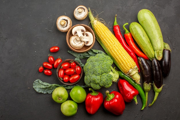 Top view fresh ripe vegetables composition on grey background