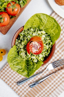 Top view of fresh salad with quinoa tomatoes and cucumbers