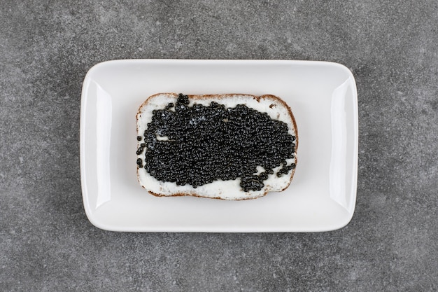 Top view of fresh sandwich with black caviar.