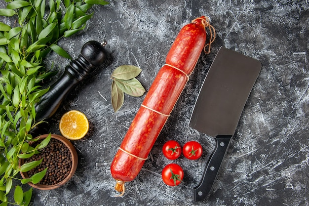 Top view fresh sausage with pepper on the dark background color food burger sandwich meat bread meal