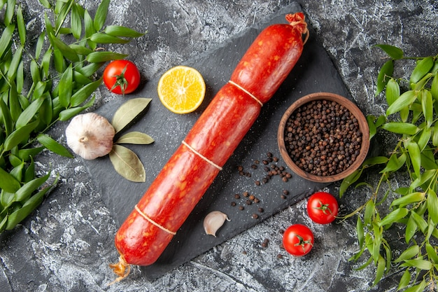 Top view fresh sausage with pepper on light dark background sandwich meat food bread meal color animal