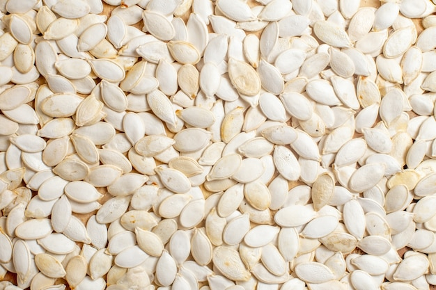 Top view of fresh seeds lined on a wooden desk