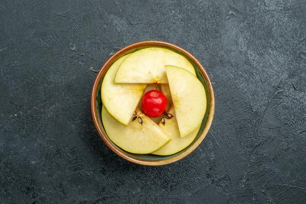 Top view fresh sliced apples inside little pot on grey surface fresh fruit mellow ripe