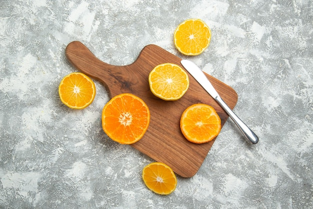 Top view fresh sliced oranges mellow citruses on a white surface ripe fruit exotic fresh tropical