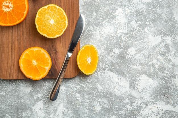 Top view fresh sliced oranges mellow citruses on the white surface ripe fruit exotic fresh tropical