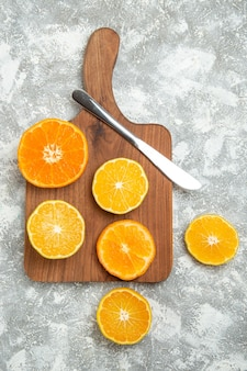 Top view fresh sliced oranges mellow citruses on white surface ripe fruit exotic fresh tropical