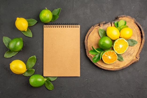 진한 회색 테이블 과일 감귤 라임에 상위 뷰 신선한 신 레몬