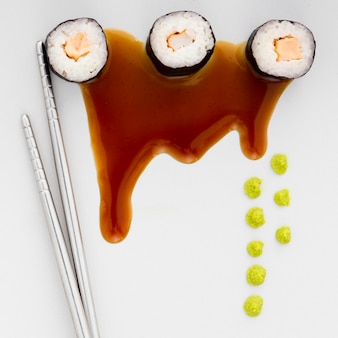 Top view fresh sushi rolls with soy sauce