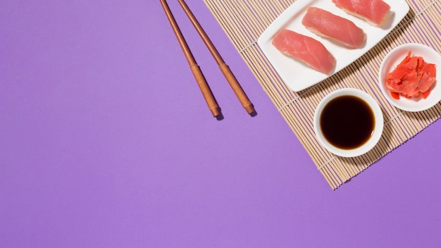 Top view fresh sushi with soy sauce and chopsticks