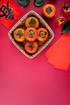 Top view of fresh sweet persimmons kaki with leaves. chinese lunar new year.
