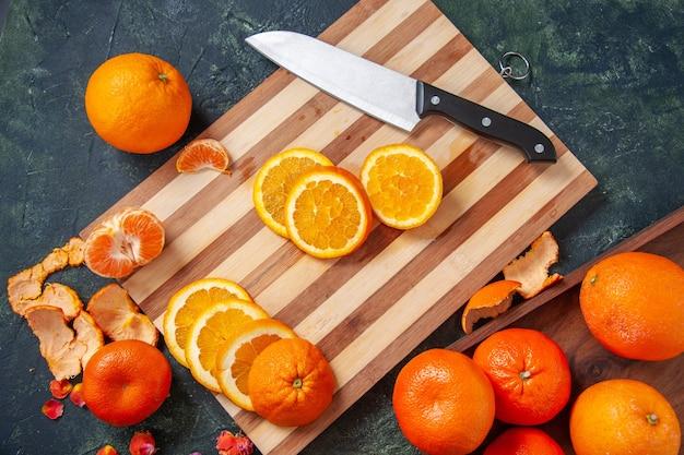 Top view fresh tangerines with oranges on dark background vegetable diet salad drink food citrus fruit meal exotic