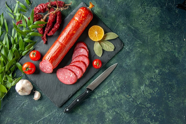 Top view fresh tasty sausage with tomatoes on blue background bread meat food burger sandwich bun color