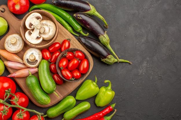 Top view fresh vegetables composition on dark desk