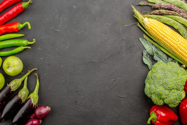 Top view fresh vegetables composition on grey background