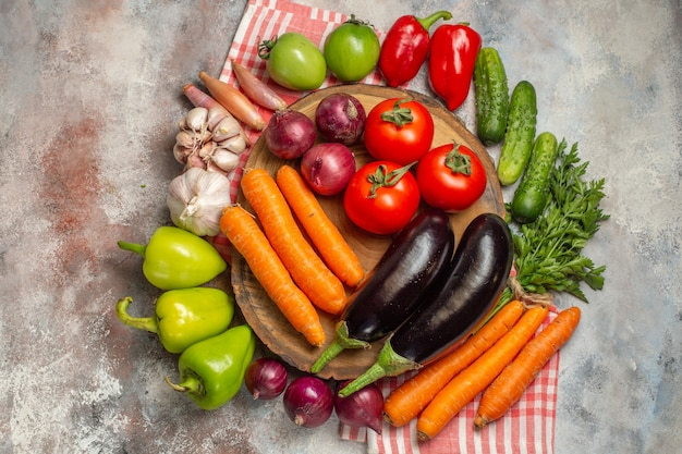Top view fresh vegetables composition on a white background