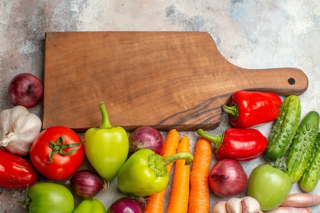 Top view fresh vegetables composition on white background