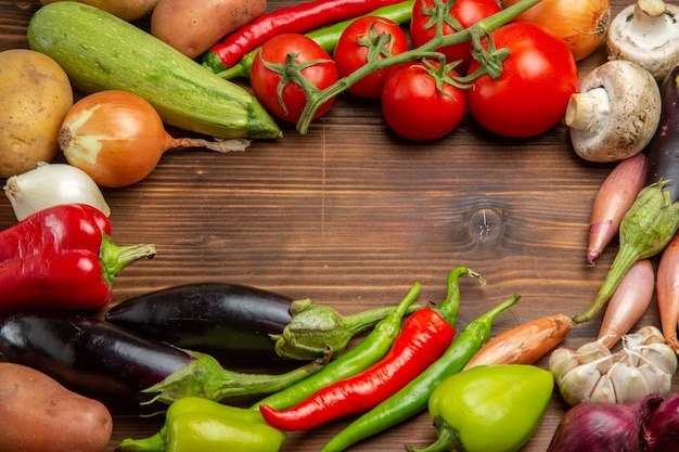Top view fresh vegetables composition on wooden desk