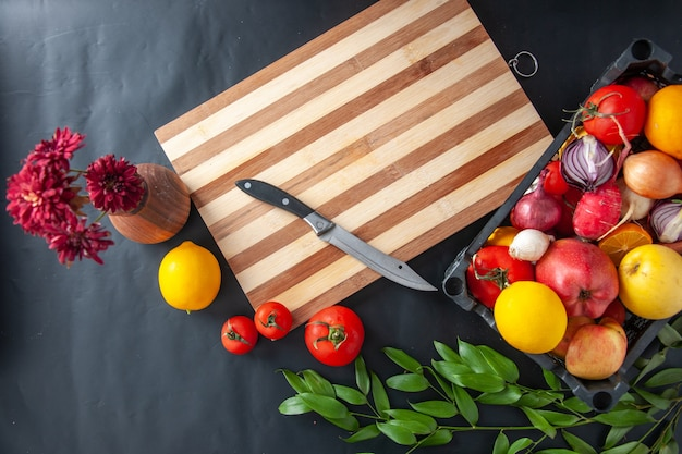 Top view fresh vegetables on dark background cooking cake job biscuit bake dough pastry pie