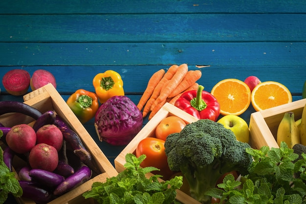 Top view of fresh vegetables on table, fresh vegetables in wooden container
