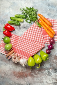 Top view fresh vegetables with greens on light background