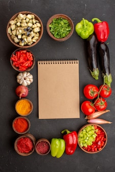 Top view fresh vegetables with greens and seasonings on grey desk meal salad health food vegetable