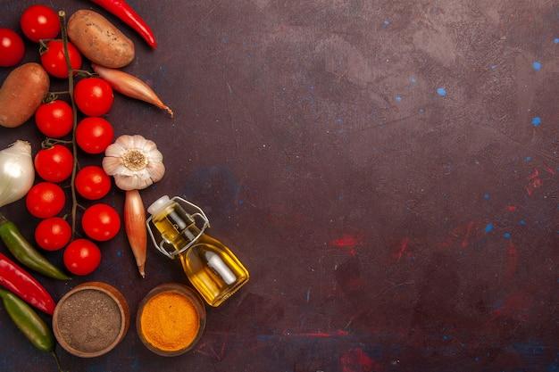 Top view fresh vegetables with seasonings on dark-purple space