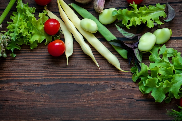 Top view of fresh vegetables on wooden table background with copy space