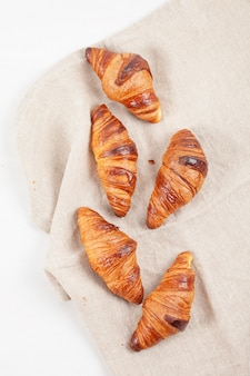 Top view over freshly baked croissants for breakfast