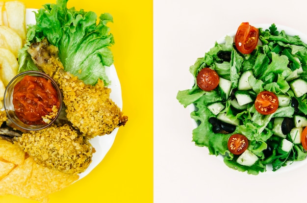 Top view fried chicken vs salad