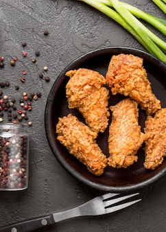 Top view fried chicken with pepper and green onions