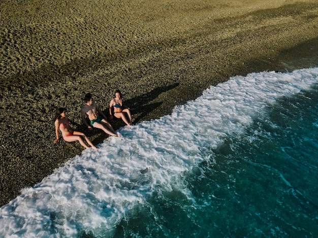 Top view of friends relaxing at the beach
