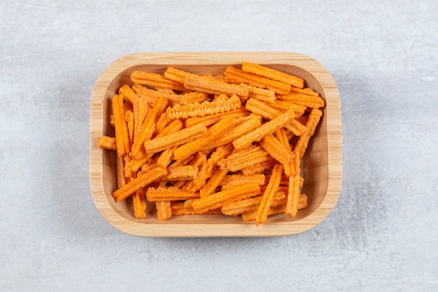 Top view of fries crisp in wooden bowl.