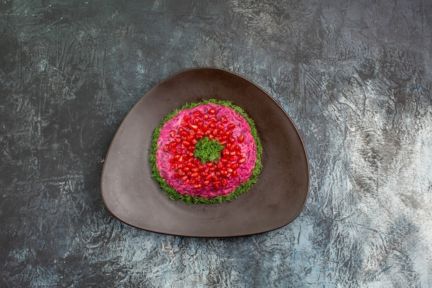 Top view from afar dish an appetizing dish with pomegranate seeds herbs
