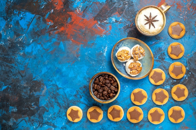 Top view from afar sweets coffee beans chocolate cookies a cup of coffee turkish delight