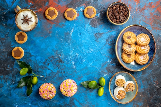 Top view from afar sweets cookies coffee beans citrus fruits turkish delight