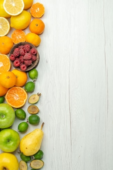 Top view fruit composition fresh fruits on white background
