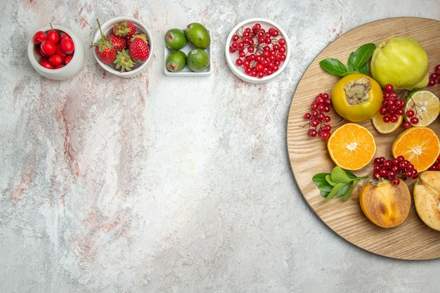 Top view fruit composition fresh fruits on white table