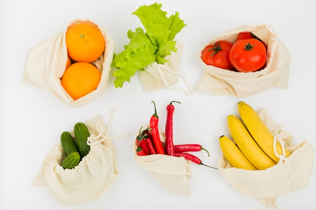 Top view of fruit and vegetables in reusable bags