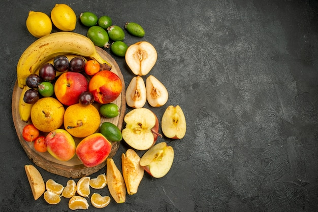 Top view fruits composition fresh fruits on grey background