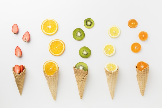 Top view of fruits and ice cream cone arrangement
