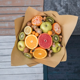 Top view of fruits and nuts bouquet wrapped in kraft paper