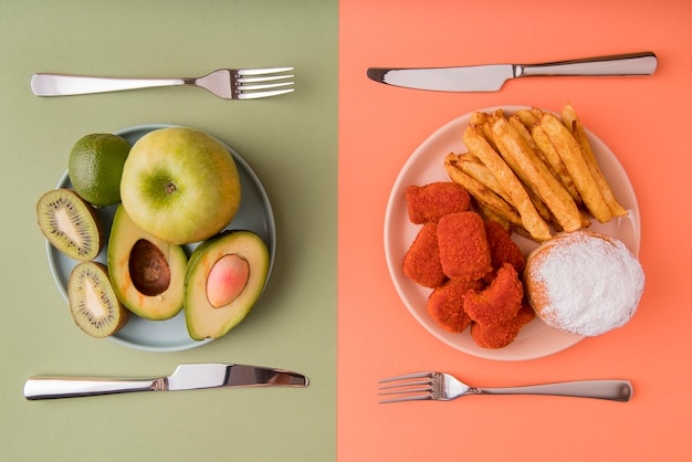 Top view fruits versus unhealthy food