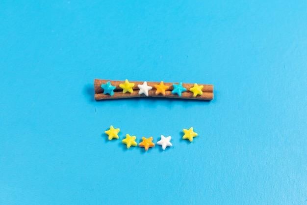 Top view ful sweet candies lined on blue background