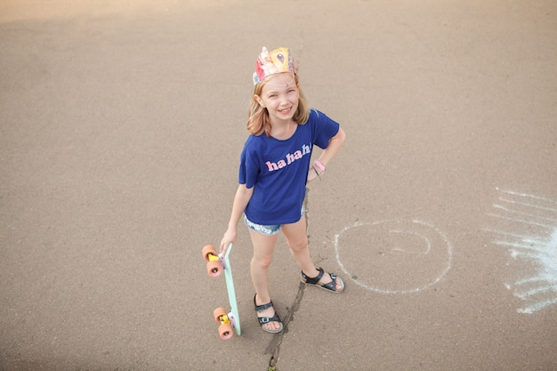 Top view full length shot of a cheerful young girl smiling