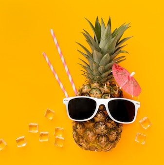 Top view funny pineapple with sunglasses