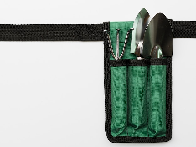 Top view gardening tools on bag