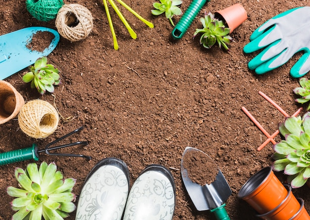 Top view of gardening tools on the ground