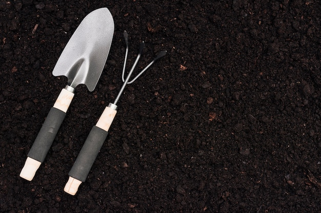 Top view gardening tools on the ground