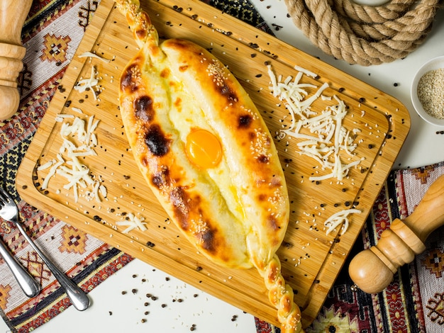 Top view of georgian khachapuri cheese and egg bread